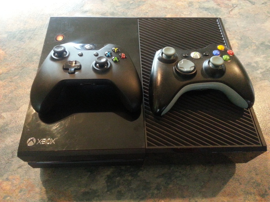 Old with new: Here's the old controller alongside the new Xbox One, er, one.