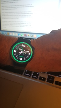 The Huawei Smartwatch's sporty green watch face. That green circle? That fills up the more active you are.